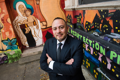 Jose Muñoz, vice president of community ownership at The Resurrection Project (TRP), a community-based nonprofit that works in Pilsen, Little Village, and Back of the Yards